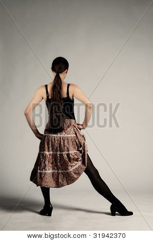 Young dancer woman with color skirt dancing poster