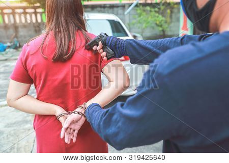 Thief With Gun Trying To Steal Car Or Money From Unaware Woman With Automobile And Tie Her With Chai
