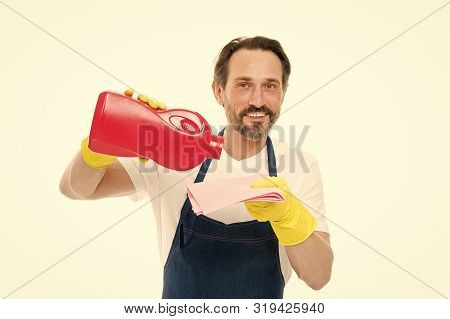 Today is washing day. Cleanup man pouring washing gel on wiper. Household worker wearing protective rubber washing gloves. Mature man doing his washing or laundering. poster