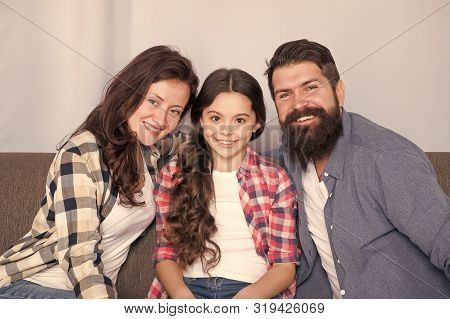 Friendly Family Sit Couch Posing For Photo Family Album. Mom Dad And Daughter Relaxing On Couch. Clo
