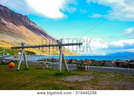 Isafjordur, Iceland, A Swing On The Seafront At Sunset