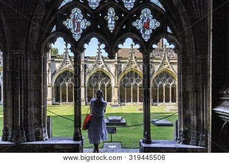 Canterbury, Great Britain - May 15, 2014: An Unidentified Woman Stands In A Gallery In Front Of The