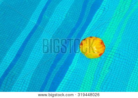The Yellow Leaf Floating In Swimming Pool