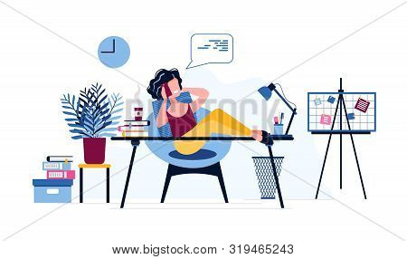Happy And Lazy Female Office Worker Put Her Legs On The Desk And Speaks On The Phone, Instead Of Per