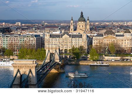 Budapest, panorama on the Chain Bridge and the Danube River, the Gresham Palace and the St. Stephen's Basilica in the Pest district