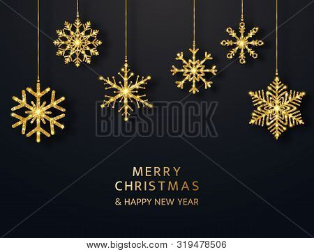 Merry Christmas Greeting Card With Hanging Glitter Snowflakes. Bright Gold Baubles On Black Backgrou