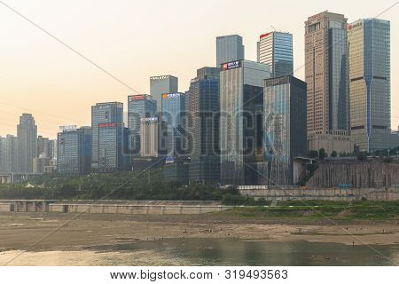 Chongqing, China - May 10, 2019 : Cityscape And Skyline Of Downtown Near Chongqing Dongshuimen Bridg