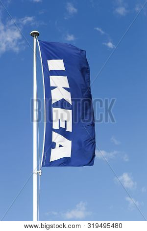 Lyon, France - July 27, 2015: Ikea Flag On A Pole. Ikea Is A Multinational Group Of Companies That D