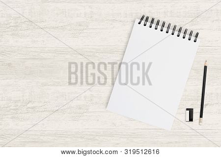 Top View Object Background Of Blank Notebook And Pencil On Wood.