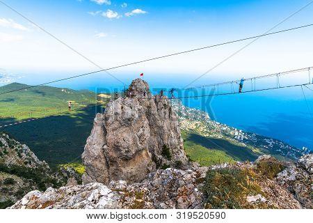 Ai-petri, Crimea - July 5, 2019. Suspension Bridge On Top Of The Mountain