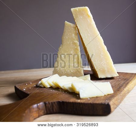Wooden Table With Parmesan Cheese. Food. Healthy Food. Wooden Board With Parmesan. Italian Food. Lif