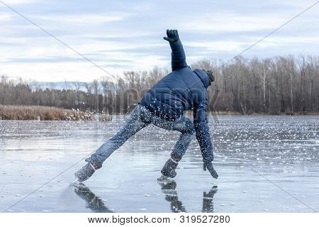 Skating On The Lake. Man Falling Down While Ice Skating. Ice Skating Outdoors On A Pond Or River. Vi