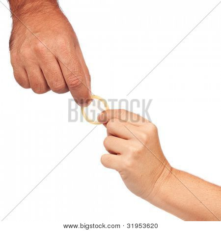 Man and woman's hands holding a condom isolated on a white background