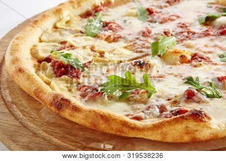 Pizza Four Cheeses or Ai Quattro Formaggi Pizza with Blue and White Mold Cheese, Goat Cheese, Mozzarella and Parmesan Isolated. Traditional Italian Whole Yeasted Flatbread on Wooden Plate Close Up