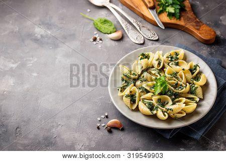 Conchiglioni Pasta With Spinach In Creamy Sauce. Selective Focus