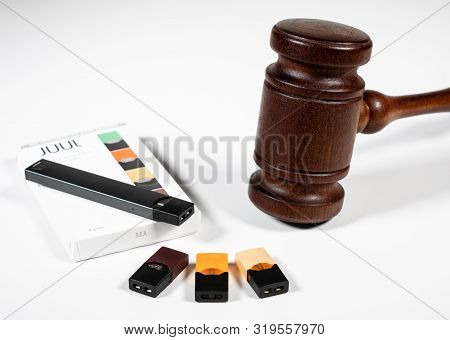 Morgantown, Wv - 29 August 2019: Juul E-cigarette Or Nicotine Vapor Dispenser Box With Judges Gavel
