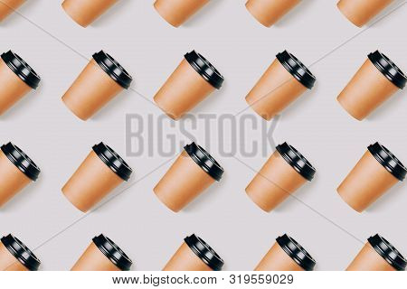 Seamless Pattern Of Many Coffee To Go Paper Cups On Grey Background. Open Composition. Flat Lay Styl