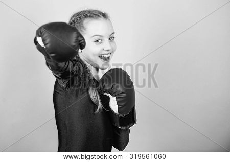 Feminism Concept. With Great Power Comes Great Responsibility. Boxer Child In Boxing Gloves. Girl Cu