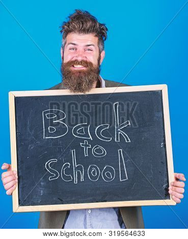 Continue Your Education With Us. Teacher Bearded Man Stands And Holds Blackboard With Inscription Ba