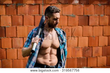 Man Unshaven Face Muscular Torso Hold Black Baseball Bat. Strong Temper. Principle Concept. Confiden