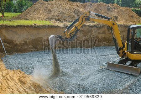 A Yellow Excavator Bucket Shovel Moving Gravel Stones Of Foundation On A Construction Site Stone Bac