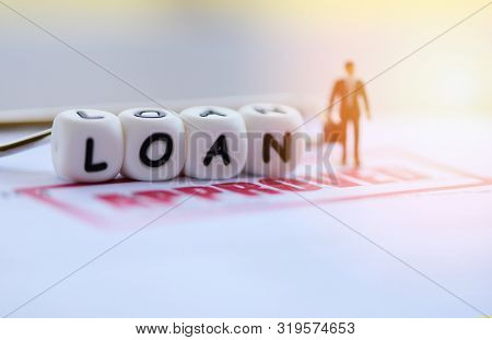 Loan Approval / Businessman Financial Standing On Loan Application Form For Lender And Borrower For