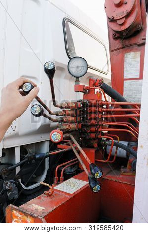 Leverage Of Rusty Red Crane Truck Manually Operated Hydraulic Control  With Measuring Device And Mal