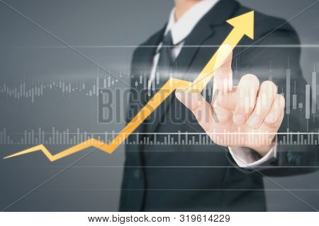 Businessman  Touching Stock Graph Indicating Growth