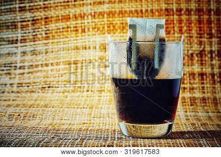 Drip Or Brewed Coffee On  Bamboo Weave Texture Paper Dripping Bag On A Cup