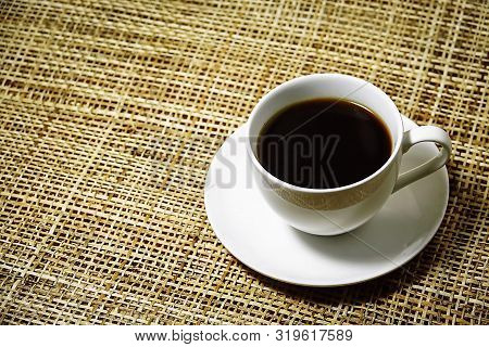 White Cup Of Espresso Coffee On Bamboo Weave Background