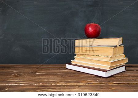 Red Apple Over Pile Of Books For Shool Concept. Education Concept, Toned And Soft Focus Image