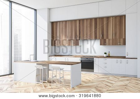 Corner Of Modern Kitchen With White Walls, Wooden Floor, White Countertops, Wooden Cupboards And Whi