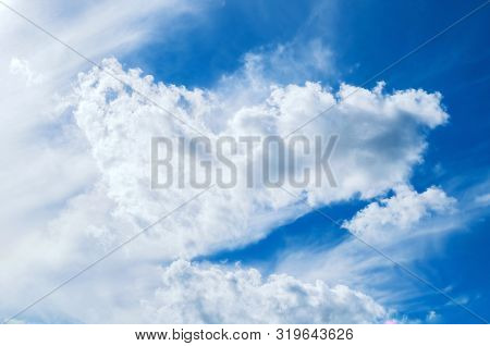Blue dramatic sky background - picturesque colorful cloud lit by sunlight. Vast sky landscape panoramic scene, colorful sky view. Sunny blue sky background, vast sky scene