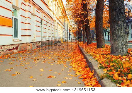 Veliky Novgorod, Russia. The Old Town district in Veliky Novgorod at fall sunny morning. Fall city landscape in retro tones