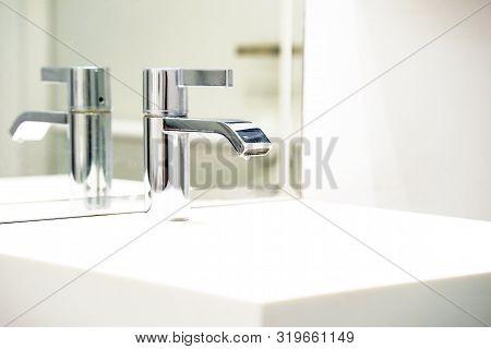 Bathroom Interior Sink With Modern Design. Interior Of Bathroom With Washbasin And Faucet. Public Ba