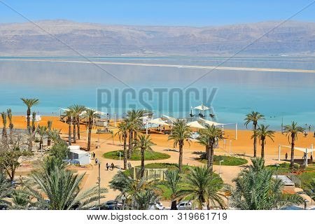 Dead Sea, Ein Bokek, Israel - July 14, 2019 : Vacationers And Tourists Bathe In The Dead Sea, Public