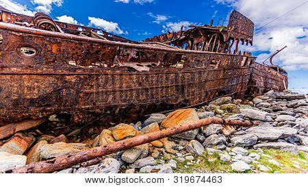 Detailed Side View Of The Plassey Shipwreck On The Rocky Beach Of Inis Oirr Island, Abandoned Ship,