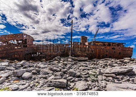 Side View Of The Plassey Shipwreck Located On The Rocky Beach Of Inis Oirr Island, Abandoned Ship, O