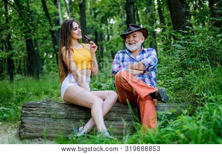 Person With Purported Magical Abilities. Girl Came To Magician In Forest. Pretty Woman And Senior Fr