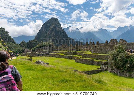 Machu Picchu, Peru - 05/21/2019:  Inca Site Of Machu Picchu In Peru With Huayna Picchu Behind.