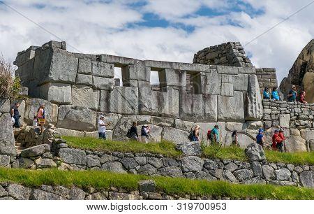 Machu Picchu, Peru - 05/21/2019: Temple Of The Three Windows At The  Inca Site Of Machu Picchu In Pe