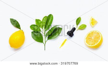 Lemon Essential Oil And Lemon Fruits On White Background.