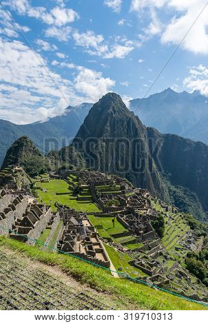 Machu Picchu, Peru - 05/21/2019:  Inca Site Of Machu Picchu And The Surrounding Andes Mountains In P