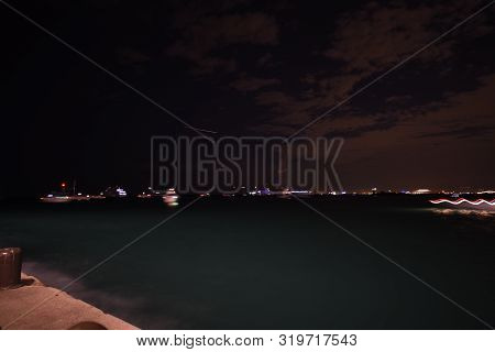 long exposure of boats near Navy Pier at night, awaiting a fireworks show poster