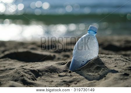 Plastic Bottle Is On The Beach Leave By Tourist. The Problem Of Pollution Of The Waters Of The Ocean