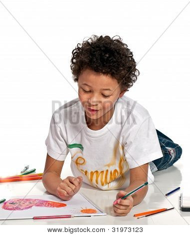 boy drawing on the floor