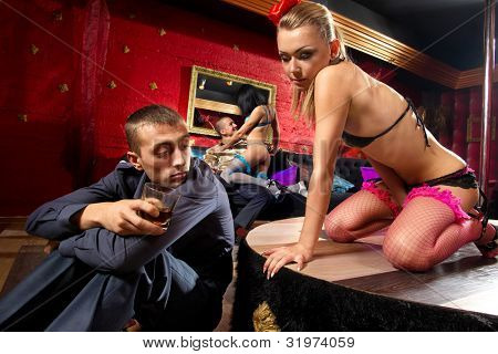View of men looking at a stripper on stage