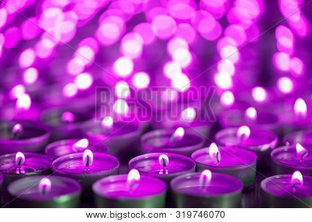 Purple Pink Candle Light. Christmas Or Diwali Celebration Tealight Candlelight. Lit Candles At Night