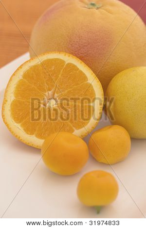 The Group Of Citrus Fruits On A White Plate