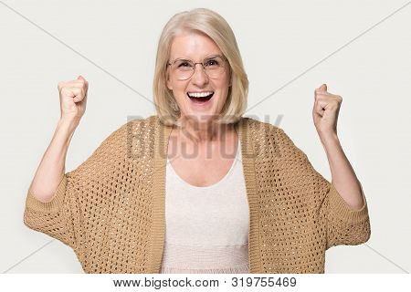 Overjoyed mature woman feel euphoric with good news poster